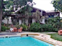 7 bedroom furnished guest house for sale at Kokrobite